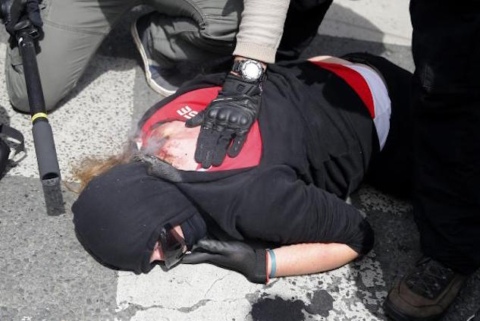 epa05363955 An injured protester lays on ground after clashes with riot police during a national demonstration and strike against the Labor Law reform in Paris, France, 14 June 2016. Labor unions demonstrated during a national strike across France to protest against about employment law reforms in the so-called El Khomri bill.  EPA/YOAN VALAT