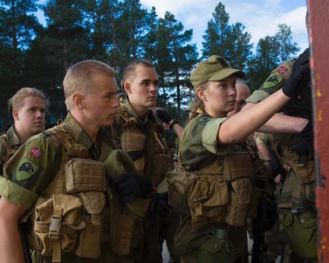 A female army recruit attends a base training next to male recruits at the armored battalion in Setermoen, northern Norway on August 11, 2016.  Norway has become the first NATO member to have compulsory conscription for women as well as men in the army. Recently, the first batch of army recruits joined the ranks in The Armored Battalion in the Norwegian Army located in Setermoen in northern Norway. / AFP PHOTO / KYRRE LIEN / TO GO WITH AFP STORY BY PIERRE-HENRY DESHAYESKYRRE LIEN/AFP/Getty Images
